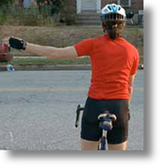 Cyclist with left arm straight out to the side